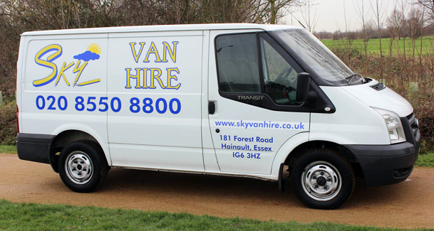 An image showing a white short wheel based Sky Van Hire van parked outside.