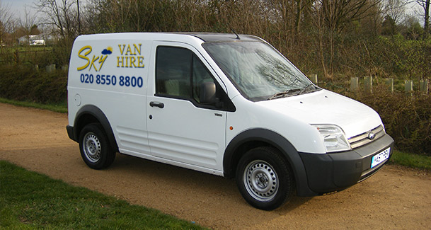 An image of a white, small Sky Van Hire van, showing the phone number and logo of Sky Van Hire